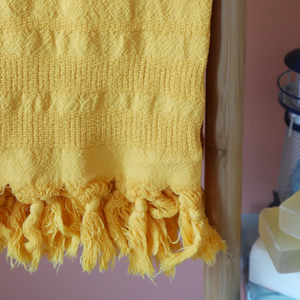 yellow beach-bath towel made of Turkish cotton