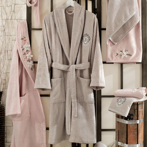 Modern bathroom designed with powder pink women robe and stone-beige men robe and bath towels.