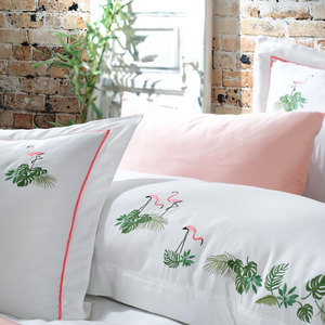 Green leaves and blush flamingos embroidered on white duvet cover and shams