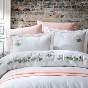 Refreshing bedroom with white-blush color bedding set, ornamented with flamingos