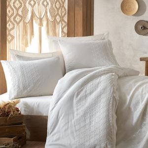 Traditional Turkish bedroom decorated with pure white, bride`s selection bed linen set which is ornamented with delicate lace