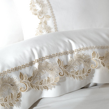 Load image into Gallery viewer, Bronze color quipure ornaments on white, bride duvet cover