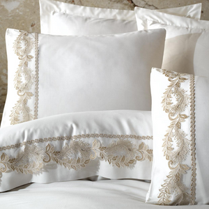 Borders of white duvet cover and shams are designed with delicate, bronze color guipure