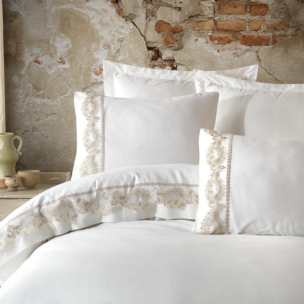Classic style bedroom decorated with white bed linen set ornamented with bronze guipure