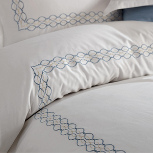 Blue and silver color, chain-shape embroideries border white duvet cover