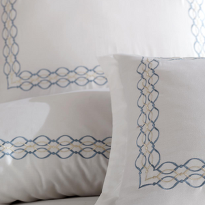 Elegant blue and silver color embroideries on cotton-sateen pillowcases