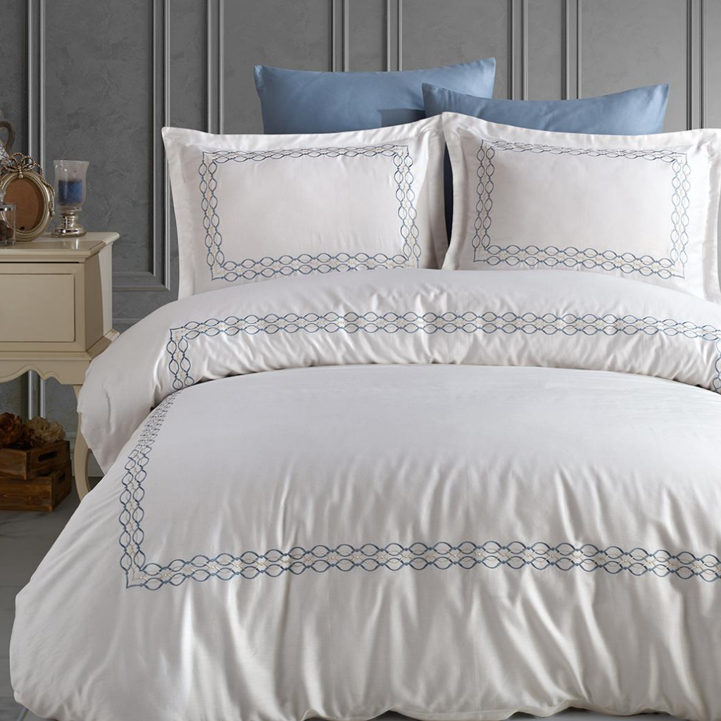 Luxurious bedroom interior designed with white-blue Turkish bed linen set