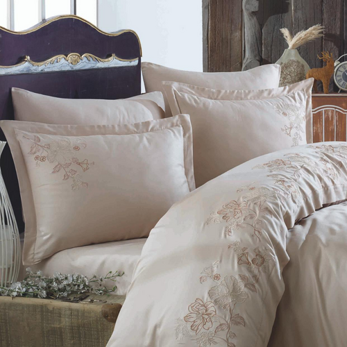 Classic bedroom decorated with beige, cotton-sateen bed linen