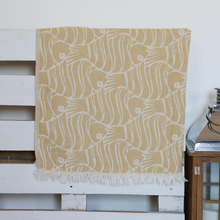 Load image into Gallery viewer, Mustard color, soft Turkish beach towel has fish designs