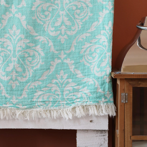 Turquoise, Turkish beach-bath towel has tassels at the edge