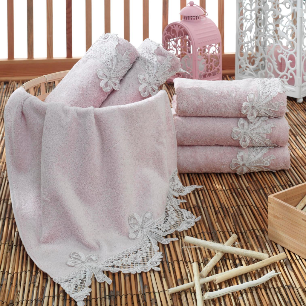 Modern decoration with candles and pearl-pink color, cotton hand towels which has lace and ribbon at the edge