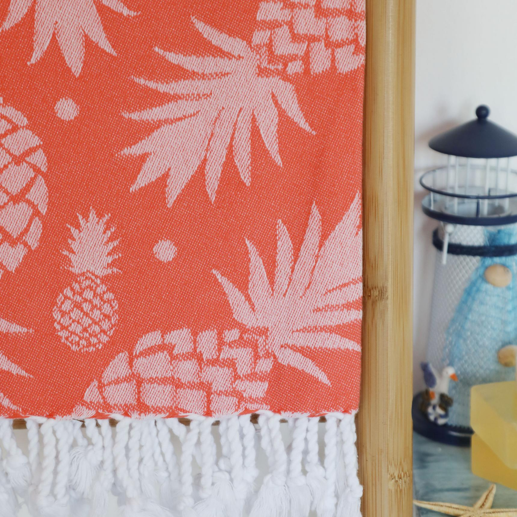 coral collar Turkish beach towel with pineapple designs on it