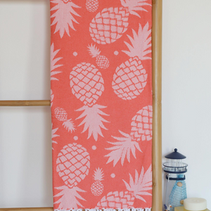 Pineapple Turkish towel in coral color with pineapple designs