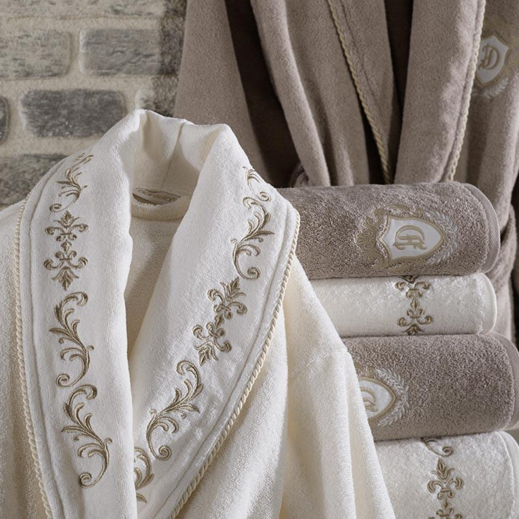 Fluffy women and men bathrobe and bath towels, ornamented with golden bronze embroidery on collars