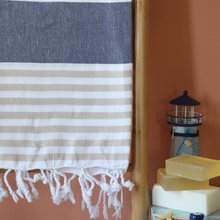 Load image into Gallery viewer, Turkish peshtemal beach towel has brown and navy stripes and tassels