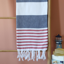 Load image into Gallery viewer, Turkish yacht towel has red and navy stripes and tassels