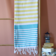 Load image into Gallery viewer, sailor peshtemal towel has blue and yellow stripes on it