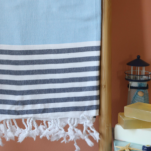 Turkish beach towel has blue and navy stripes