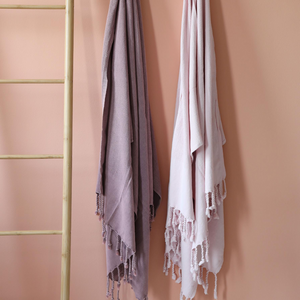 Powder-pink and dusty-rose colored 2 Turkish towels has hand-tied tassels
