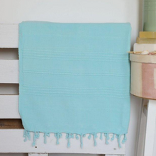 Load image into Gallery viewer, Turquoise, stone-washed Turkish towel on a bed frame