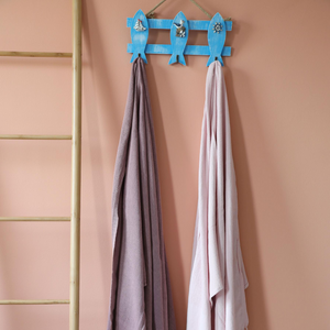 Powder-pink and dusty-rose color two Turkish peshtemal beach towels hanging on a wall