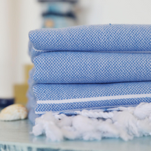Load image into Gallery viewer, Blue, light-weight Turkish bath towels on a table