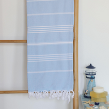 Load image into Gallery viewer, Sky-blue color Turkish beach towel on a ladder