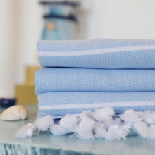 Load image into Gallery viewer, Sky-blue, Sultan peshtemal towels on a table