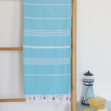 Load image into Gallery viewer, Turquoise color, absorbant Turkish beach towel on a ladder
