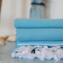 Load image into Gallery viewer, Turquoise color Turkish towels on a table