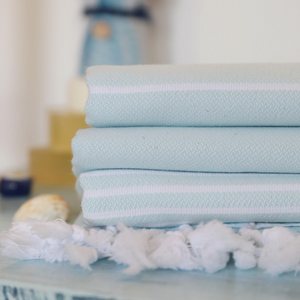 cyan color, soft Turkish beach towels on a table