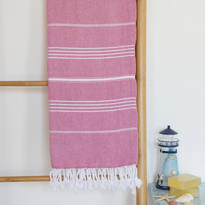 Pink, Turkish beach towel has white stripes