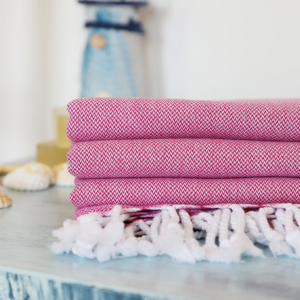 Light-weight, pink Turkish towels on a table