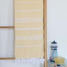 Load image into Gallery viewer, Yellow, peshtemal towel on a ladder