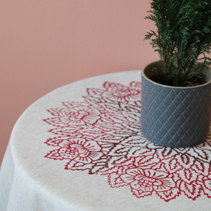 table cloth has hand-made, red, floral prints