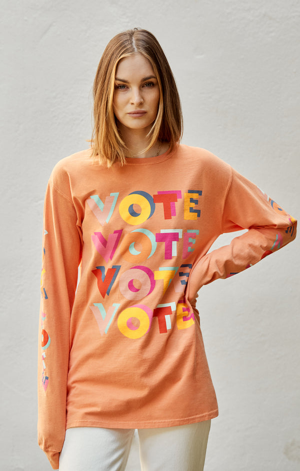 ACLU SoCal x Haas Brothers Long Sleeve Tee Orange You Glad You Didn't Vote Him on female model front