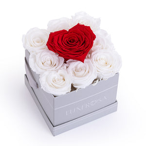 Red Forever Heart Rose on a base of 9 White Forever/ Infinity Rose's that last a Year