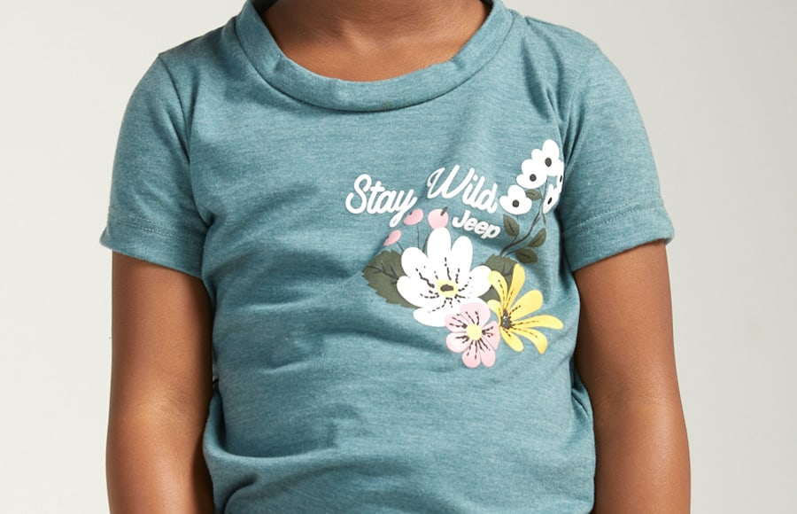 Jeep Kids girl with teal tee shirt with a stay wild print.