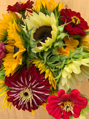 Beautiful red and yellow flower arrangement Sunflowers zinnias flowers