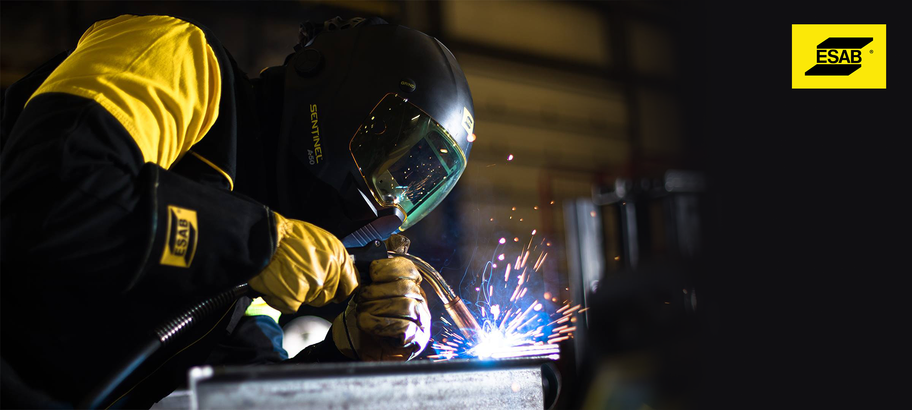 A welder with an ESAB Sentinel A50 MIG welding a project