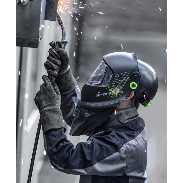 a welder wearing the Panoramaxx and an Optrel Bump Cap while MIG welding a project