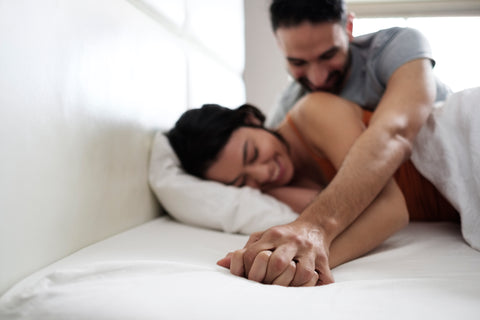 A couple in bed, thinking it would be a good idea to have amazing oral sex.