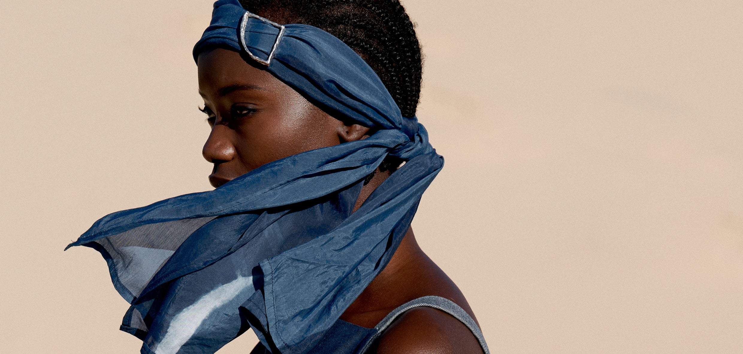 Aura Studios Flow Headscarf, naturally indigo dyed with handcrafted silver closure.