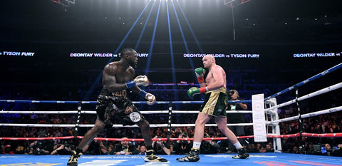 Fury outboxes Wilder in the first fight but fail to claim the victory