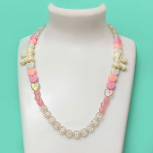 PROGRESSIVE in pink beaded choker