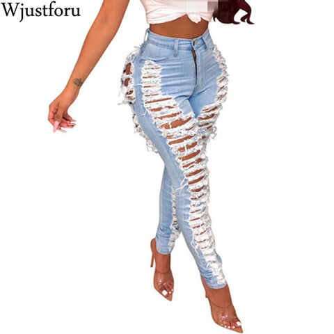 Image of Wjustforu Sexy Ripped Jeans For Women Fashion Casual Club Hole Denim Pants Femme Bodycon Hollow Out Pencil Long Jeans Vestidos