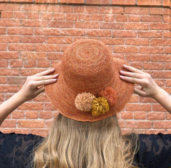 Straw Hat with Straw Pom Poms