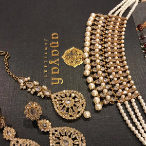 Steal the show with this simple choker necklace. Beautiful choker set with matching earrings and tikka. This delicate choker will enhance the beauty of any outfit with dominating strands of pearls for indian and pakistani style wedding in Canada-Vancouver