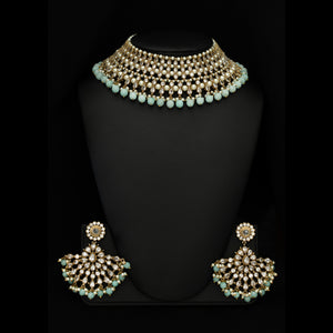 Wear this pleasing Polki crystal-made necklace and make a statement wherever you go. Designed with fine detailing, this is a unique necklace ideal for modern brides. The effortless weaving of pearls along with light blue semi-precious stones is nothing less than perfection.Available in USA -New York - New Jersey