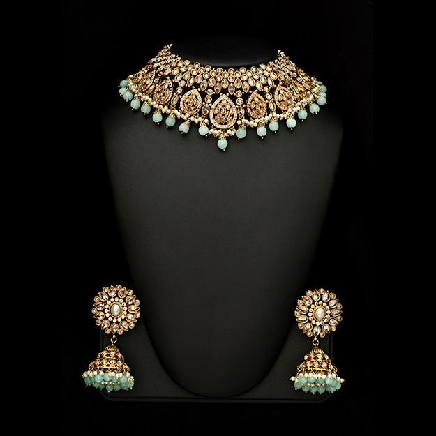 A stunning set perfect for your special event! Embellish your look with this stunning piece of polki crystal set. This is our bestselling set and is set in polki crystals and the drops can be matched to your outfit. Colours can be customsied to match your outfit.Available in Canada- Toronto - Vancouver- Montreal